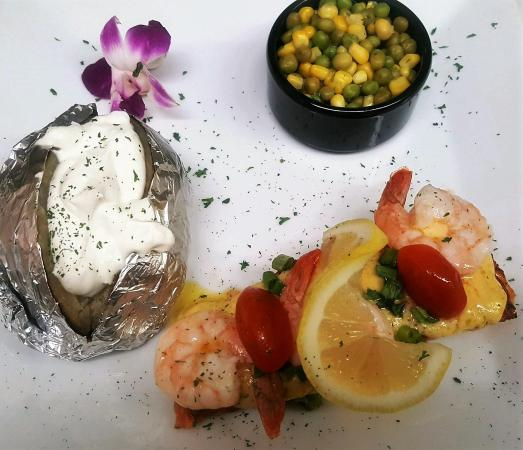 Soda Springs, ID: Try our Felix.  Grilled Salmon with Hollandaise sauce, topped with tiger shrimp