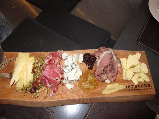 Cornerstone Cheese & Charcuterie: The kitchen view from your seat; crab cakes; fennel sweet Italian sausage; large board - meats,
