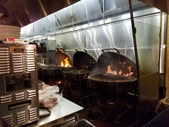they really do cook on giant charcoal grills picture of weber grill restaurant chicago. Black Bedroom Furniture Sets. Home Design Ideas