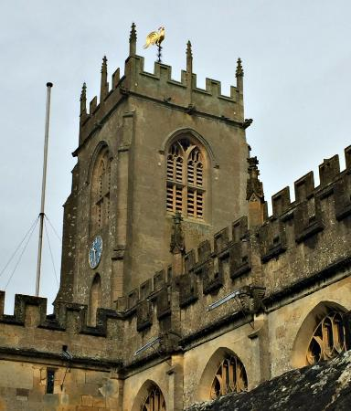 Winchcombe, UK: St. Peter's church tower with gilded weathercock