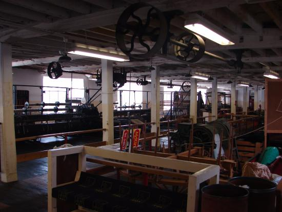 Uffculme, UK: The factory floor with wheels for belt drives.