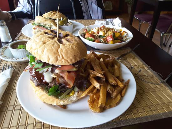 Massey, Canada: Check out the Wiskey jack burger size, regular plate, note the eyeglasses