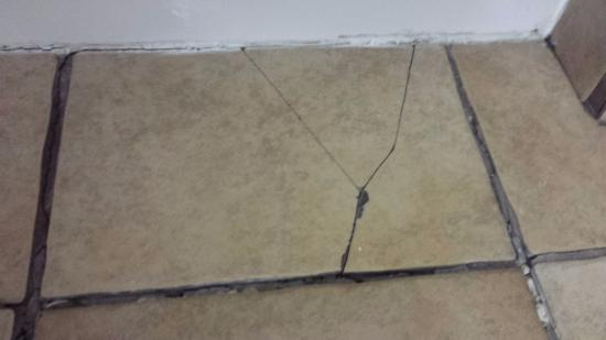 The L Motel Flagstaff Broken Tiles And Sinking Tile Floor Due To Water Damaged Subfloor