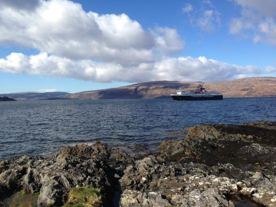 Oban Ferry arriving at Craignure Isle of Mull taken from the shoreline of the Shieling Campsite
