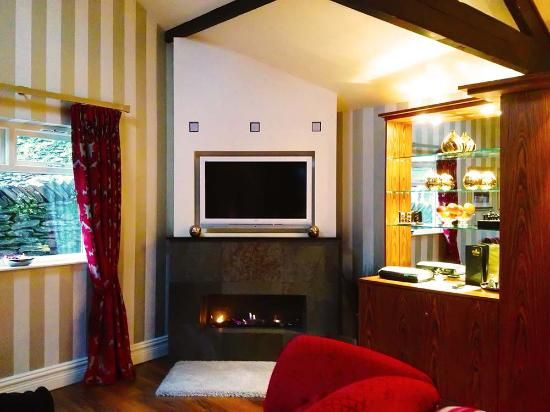 Cranleigh Boutique: Sitting area of suite with remote-controlled real-flame fire and LED TV