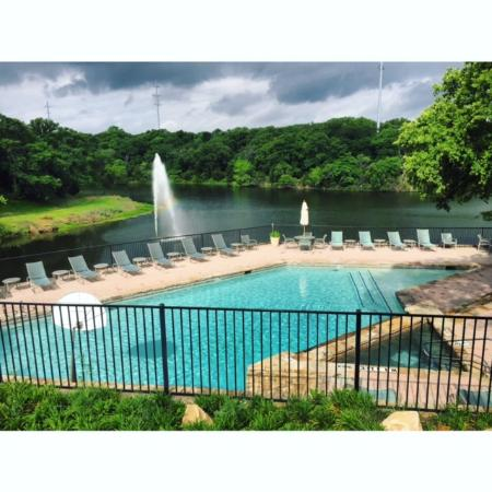 Outdoor pool with lake view. - Picture of Hilton DFW Lakes Executive ...