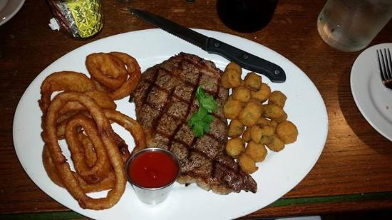 Red Rock, TX : my 12oz ribeye with onion rings and fried okra.