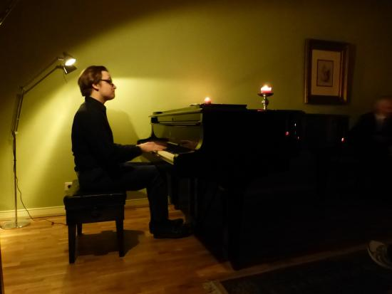 Chopin Salon: Pianist and Steinway and Sons piano at the salon concert.