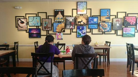 Brookfield, CT: Two teenagers enjoying painting on the ceramics.