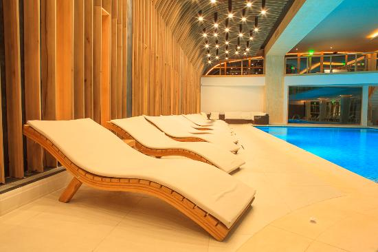 lounge chair at indoor pool area picture of forest retreat spa