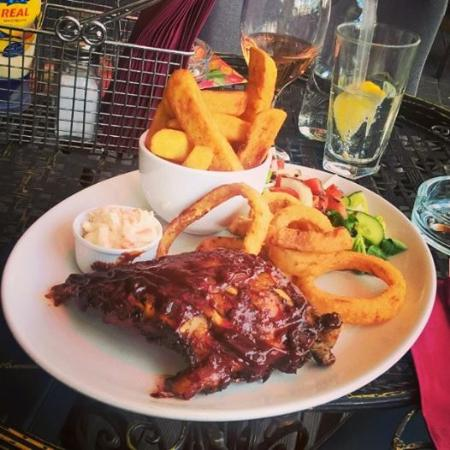 The Lodge Tavern: Excellent pork ribs,  with onion rings, fries, coleslaw ad salad. Great!