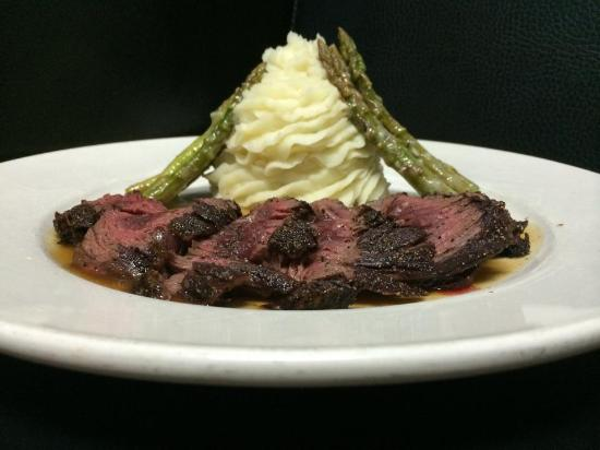 Alodia's : An 8oz certified angus pepper encrusted hanger steak served with garlic whipped potatoes, sautée