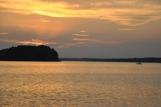 Bismarck, AR: Boat fishing on DeGray Lake at sunset.