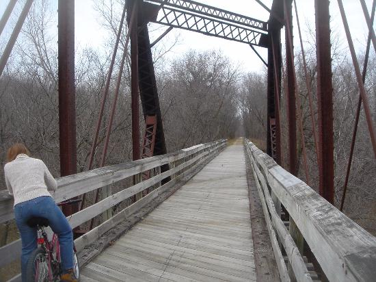 Menomonie, WI: biker on the old RR bridge