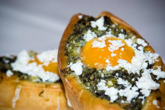 Ασβεστόλακος: Homemade dough with saute spinach,feta cheese and soft-boiled egg