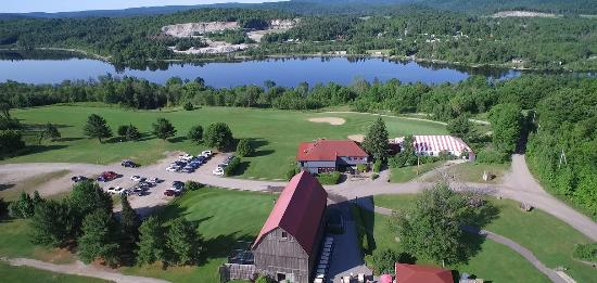 Mont Cascades Golf Club: Aerial shot of the club with the Gatineau River and Hill in the background