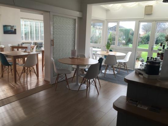 Selsey, UK: Our light and airy dining room overlooking the private gardens
