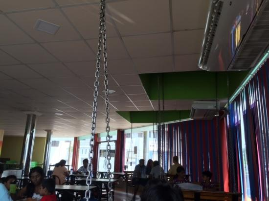 Marrybrown Family Restaurant: Inside  Chains Are Holding Swinging Bench  Type Chairs  Bizzare For