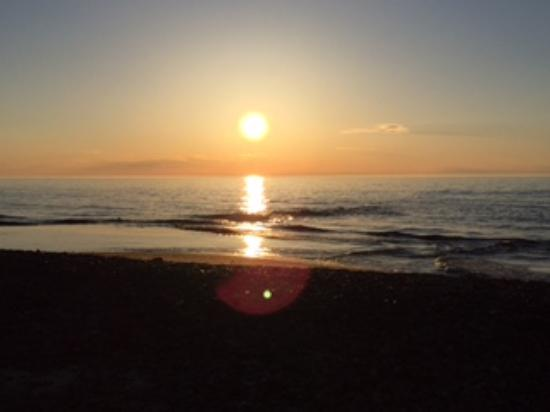 Eagle River, MI: Sunset view from Fitzgerald's Restaurant on the shore of beautiful Lake Superior!