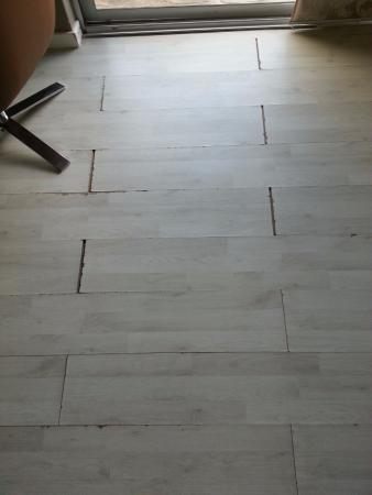 Floors Separating As A Result Of Water Damage Picture Of The