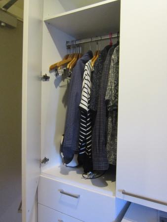 This is the closet -- half size. Notice the pants hangers. - Picture of Quest on Queen, Auckland Central - TripAdvisor