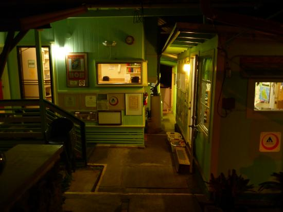 Hostelling International - Honolulu: Lobby area at night, friendly, safe and well lighted.