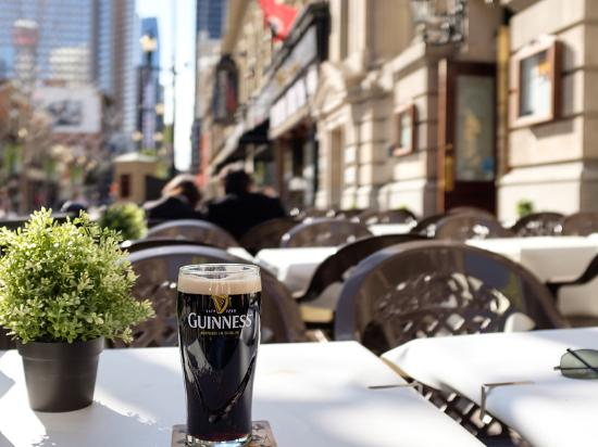 James Joyce Irish Pub : Nothing beats a Guinness on a patio
