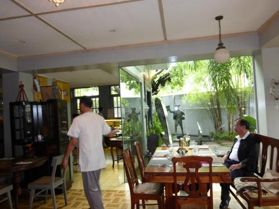 Casa Roces : A Cozy Dining Hall with a View of the Garden