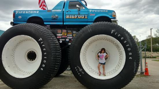 Bigfoot 4 x 4 Inc: My daughter standing in the wheel of Bigfoot # 5