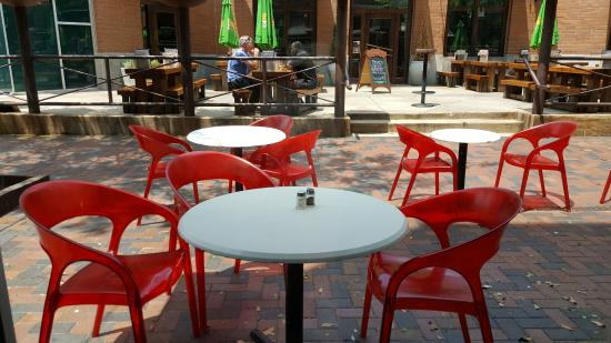 cafe s bold red outdoor dining chairs across from flying saucer