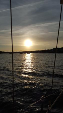 Star Charters Day Tour: Sunset over Lunenburg from the boat returning to harbor