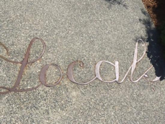 Courtenay, Canadá: Restaurant name in metal works in the sidewalk when entering  Locals Restaurant at the Old House