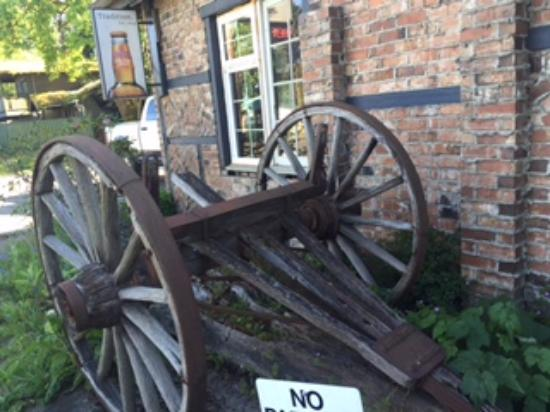 Crown & Anchor: Antique set of wheels, steel rimmed wood, Crown and Anchor Pub, Bowser, BC