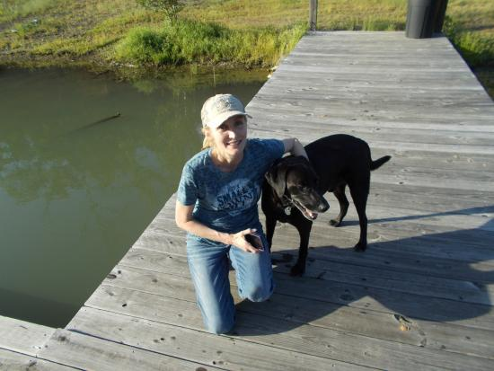 Bismarck, AR: The Pond with my walking buddy (the owners dog)