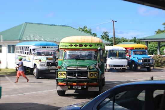 Salelologa Market: public buses at the market...