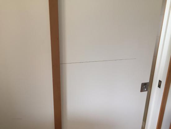 Nancy's Garden: Door to bathroom had a crack through the middle of it