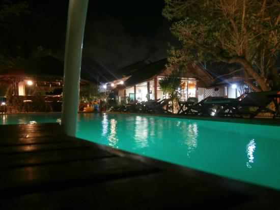 The Waterfront: The pool, bar and reception at night