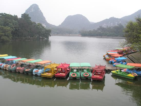 Liuzhou, China: Paddle boats available for rent on the lake.