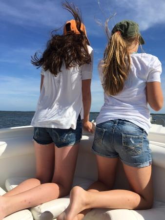 Mount Pleasant, SC: Our daughters enjoying the view from the front of the boat.