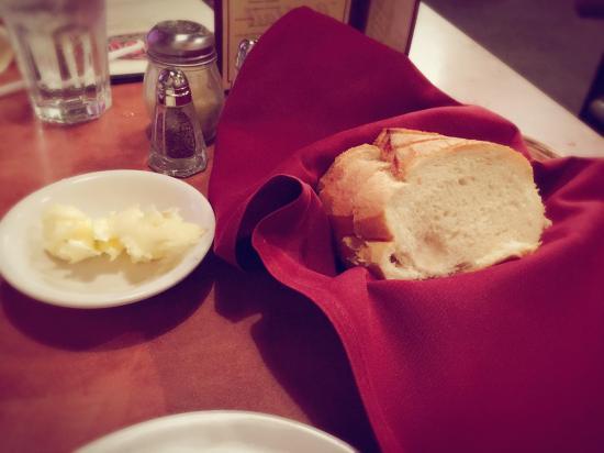 Our yummy dinner, warm bread, calamari, prime rib, brick house burger