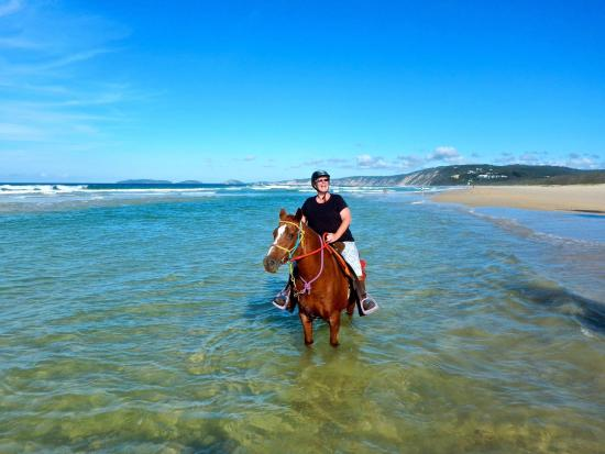 Rainbow Beach, Australia: Riding in amongst the waves is great fun.
