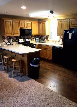 Great Branson Cabins: New kitchen floor and appliances in Nature's Serenity!