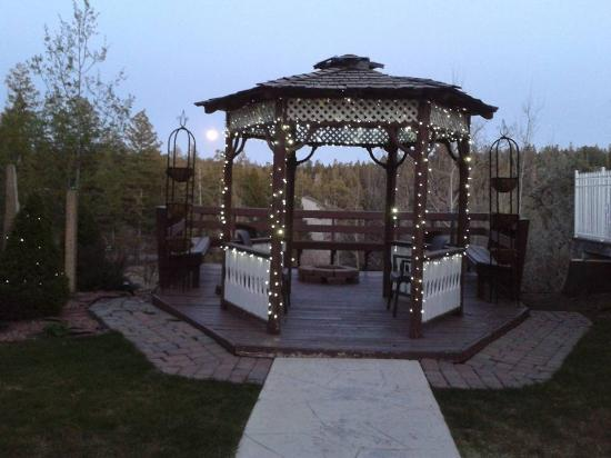 The Lodge Resort and Spa: The backyard gazebo during a full moon night.