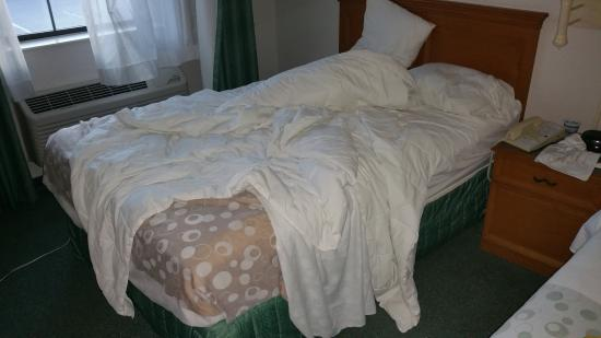 Hazelwood, MO: Maid did not make this bed on day 2. She made the other one nicely.