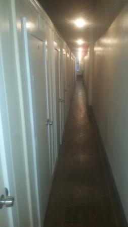 East Village Suites: Corridor of cells.
