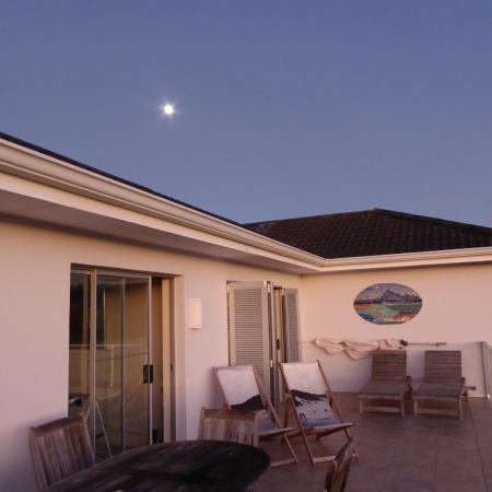 Anlin Beach House: evening view of moon from terrace leading into lounge and bedroom.