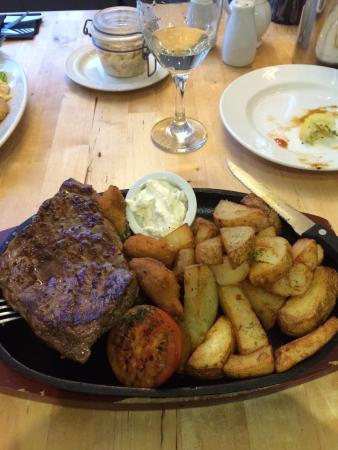 Rump steak on skillet, rescued on chips