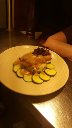 Middlewich, UK: Pan fried chicken breast, Colcannon mash, green courgettes and a peppercorn sauce