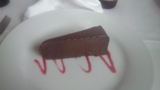 Ruth's Chris Steak House: Chocolate sin cake with raspberry coulis......so rich it will stop your heart....but worth it! :