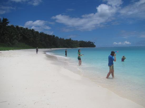 Nias Island, Indonesia: The long white sandy beach and the crystal clear water in Serambau Island
